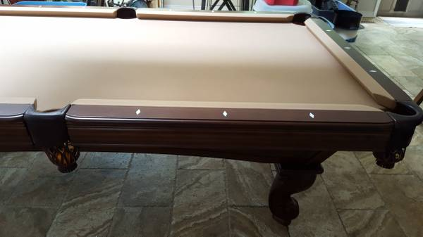 Tan Colored Felt. Two Piece Slate. Comes With Padded Ping Pong Table Top,  Cues And Wall Rack And Cover. The Pool Table Is In Like New Condition.